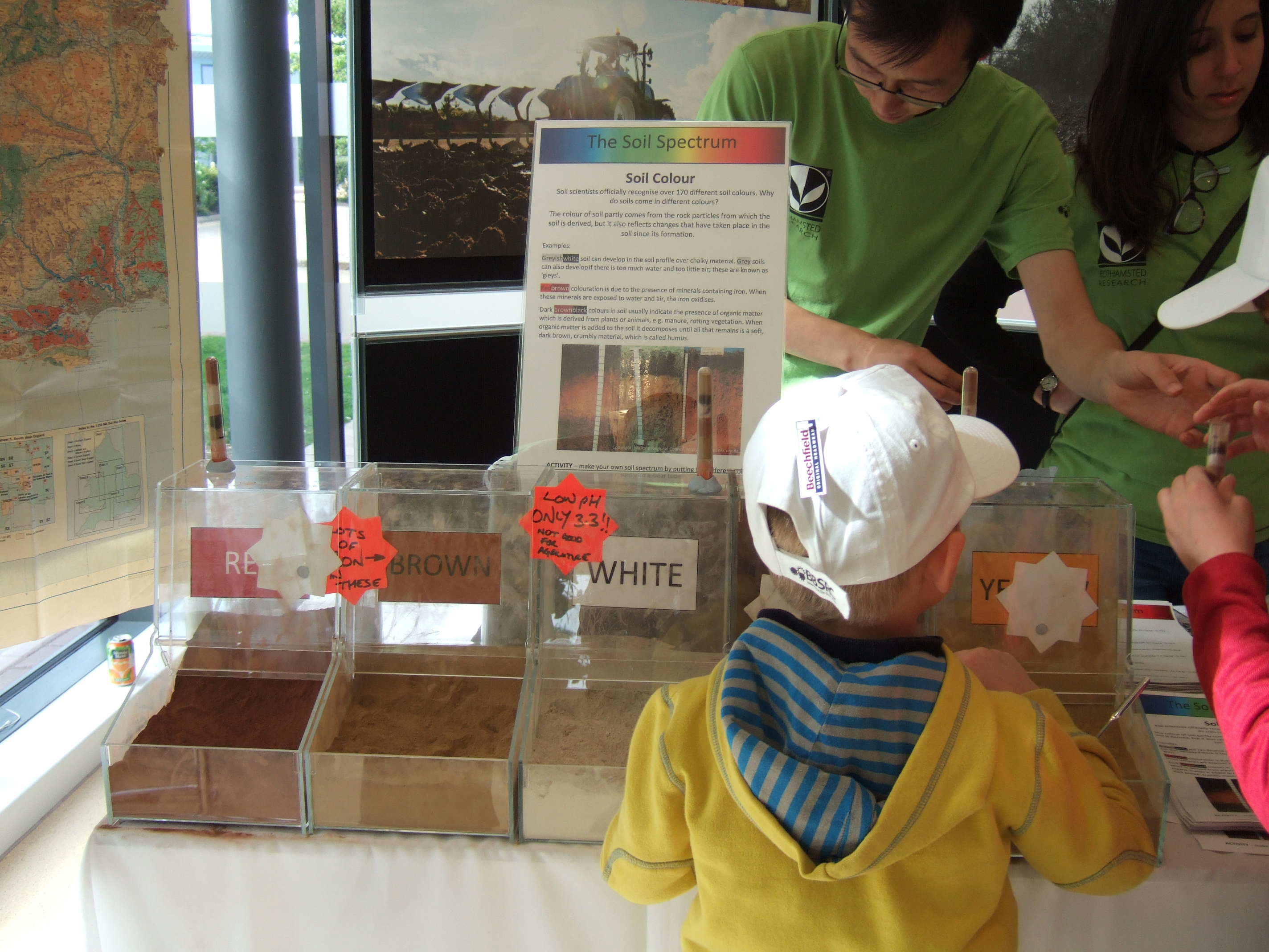 Children playing with different colours of soils